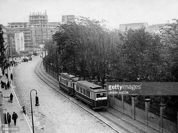 Neukoelln tram at Hermannstrasse with St Jacobi graveyard in the background the Karstadt department store at Hermannplatz under construction 1928...