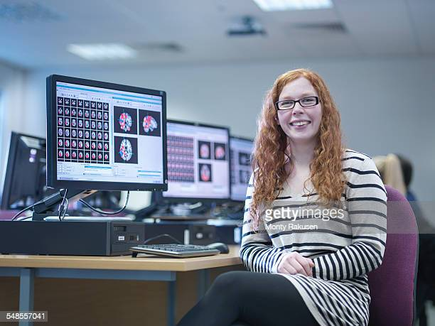 Neuroimaging student at workstation, portrait