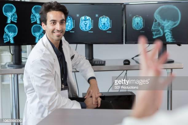 Neurologist discusses patient's x-rays