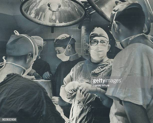 Neurosurgeon Bruce Hendrick moves to the operating table at Sick Children's Hospital His 17minute operation on the fused skull of tiny Christine...
