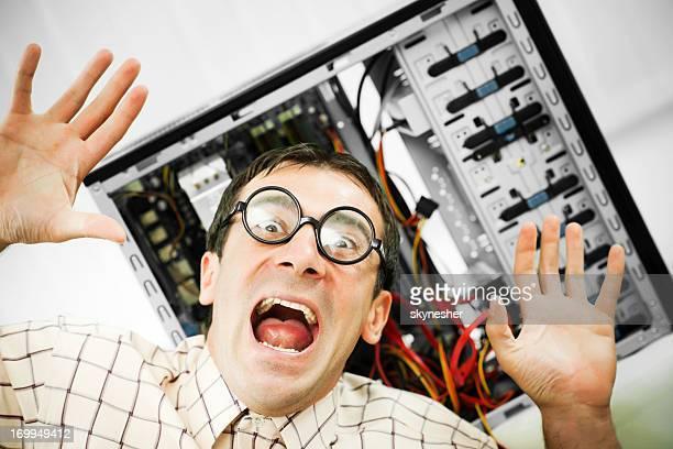 Neurotic male geek screaming.