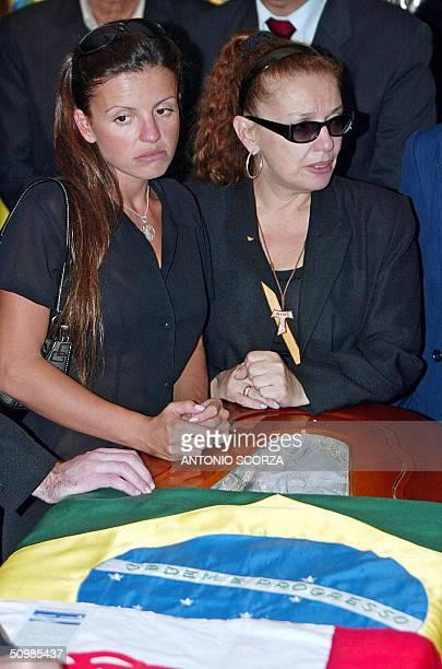 Neusa Brizola daugther of Brazilian leftist leader Leonel Brizola and an undentified relative crie beside hers father coffin in Rio de Janeiro Brazil...