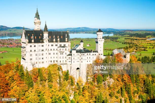 neuschwanstein castle in autumn, forggensee behind - neuschwanstein castle stock pictures, royalty-free photos & images
