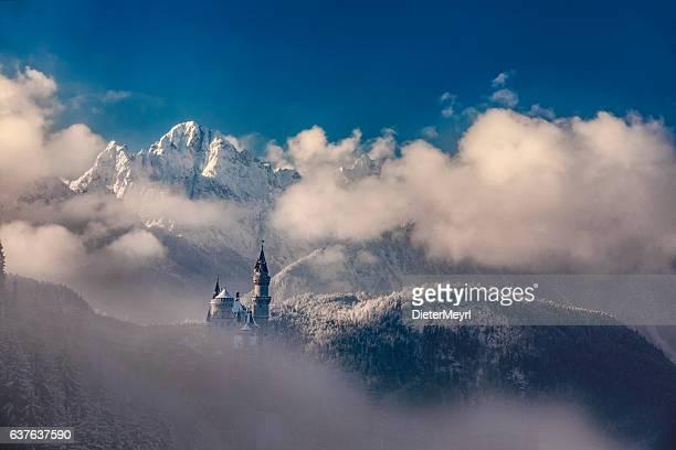 Neuschwanstein castle in Germany during misty winter morning