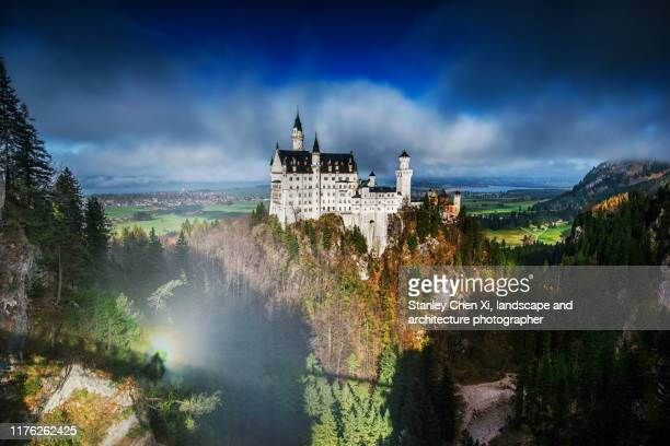 neuschwanstein castle with brocken phenomenon - light natural phenomenon stock pictures, royalty-free photos & images