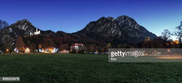 Neuschwanstein panorama at blue hour- castle and alps in nice light and colors