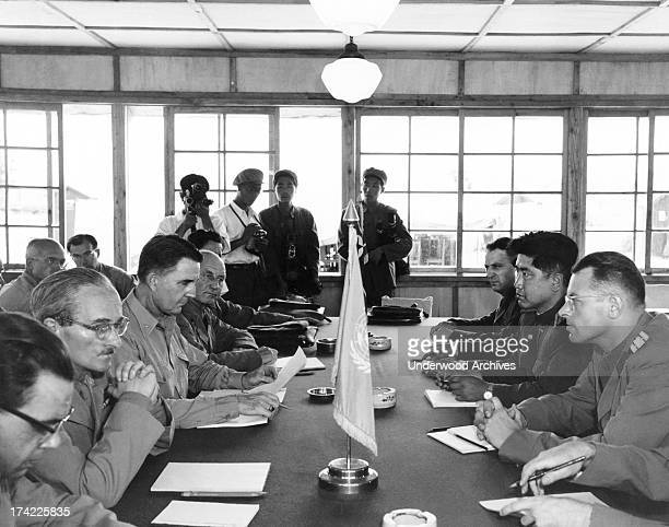 Neutral nations staff of Swiss, Swedish, Polish, and Czechoslovakian representatives meet for the first time in the building built for the signing of...