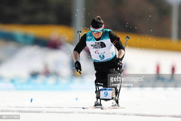 Neutral Paralympic Athlete Marta Zainullina crosses the finish line in second place to win the silver medal during the Women's 10km Biathlon Sitting...