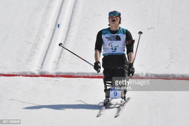 TOPSHOT Neutral Paralympic Athlete Marta Zainullina crosses the line to finish second in the women's 10km sitting biathlon event at the Alpensia...
