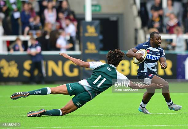 Nev Edwards of Sale Sharks outruns Jordan Olowofela of Leicester Tigers to score a try during the Singha Premiership Rugby 7s series match between...