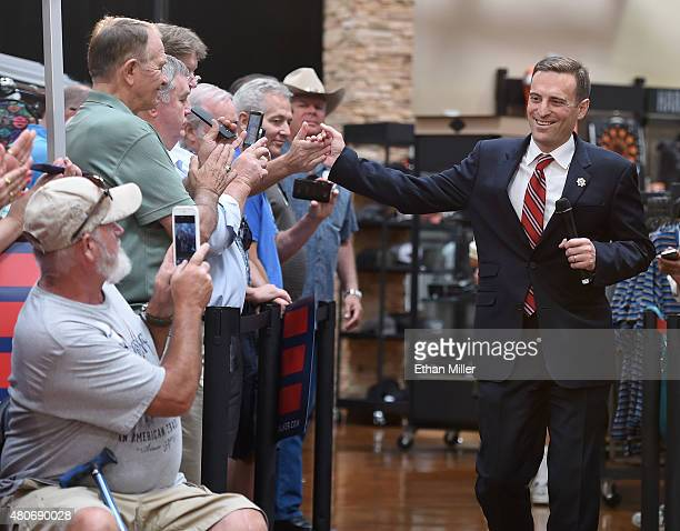 Nevada Attorney General Adam Laxalt greets people as he arrives at Red Rock HarleyDavidson to introduce US presidential candidate and Wisconsin Gov...