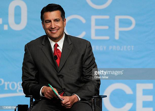 Nevada Gov Brian Sandoval smiles during the National Clean Energy Summit 40 at the Aria Resort Casino at CityCenter August 30 2011 in Las Vegas...