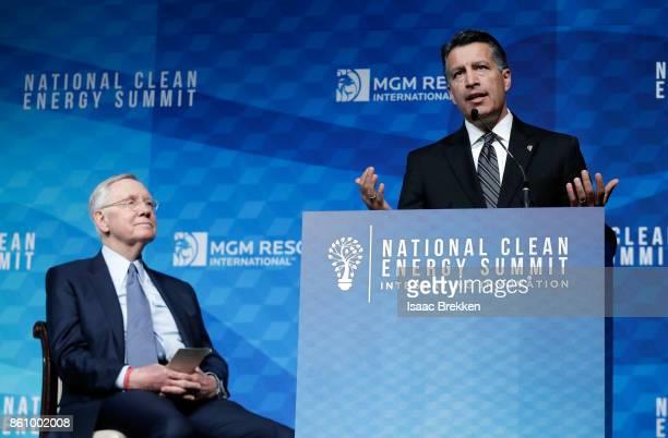 Nevada Gov Brian Sandoval speaks alongside Former US Senator Harry Reid during the National Clean Energy Summit 90 on October 13 2017 in Las Vegas...
