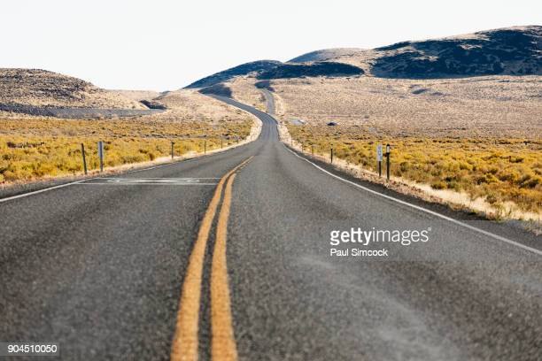 nevada, highway 50, empty road through field - nevada stock pictures, royalty-free photos & images