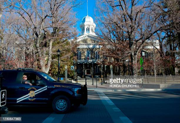 Nevada Highway Patrol vehicle passes by the State Capitol on January 17 in Carson City, Nevada during a nationwide protest called by anti-government...