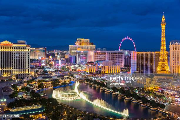 usa, nevada, las vegas, strip, fountain, hotels and eiffel tower at blue hour - las vegas stock pictures, royalty-free photos & images