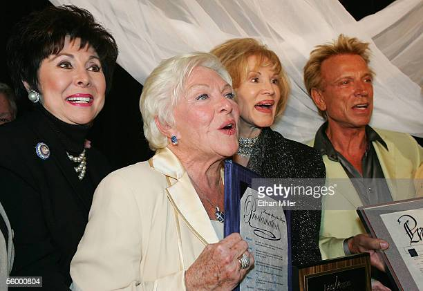 Nevada Lt Gov Lorraine Hunt legendary French entertainer Line Renaud singer Phyllis McGuire and illusionist Siegfried Fischbacher pose together after...