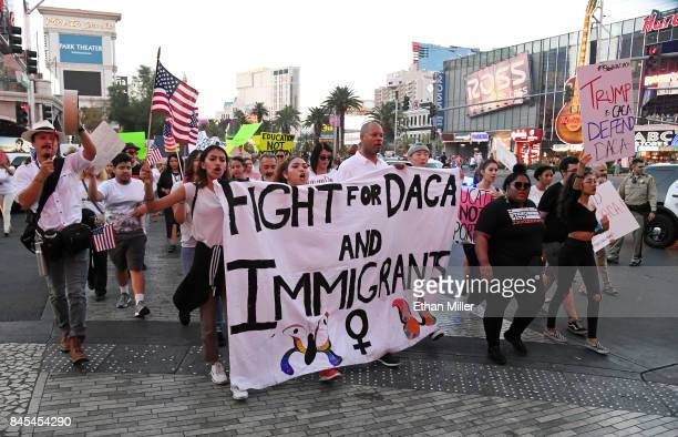 Nevada Senate Majority Leader Aaron D Ford marches with immigrants and supporters on the Las Vegas Strip during a 'We Rise for the Dream' rally to...