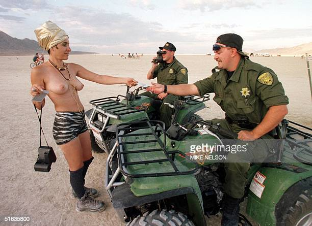 Nevada Sheriff accepts an invitation from a 'Burning Man' festival participant as another lawman videotapes the encounter in the Black Rock Desert...