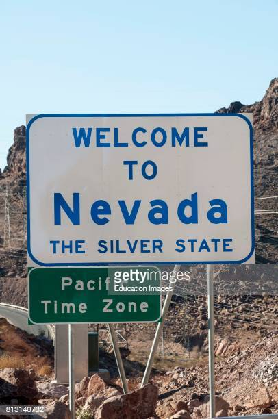 Nevada State welcome sign with pacific time zone sign