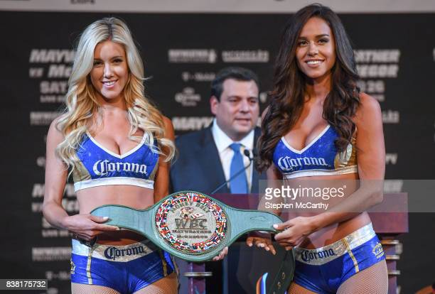 Nevada United States 23 August 2017 Promotional girls hold the belt that Conor McGregor and Floyd Mayweather Jr will fight for during a news...