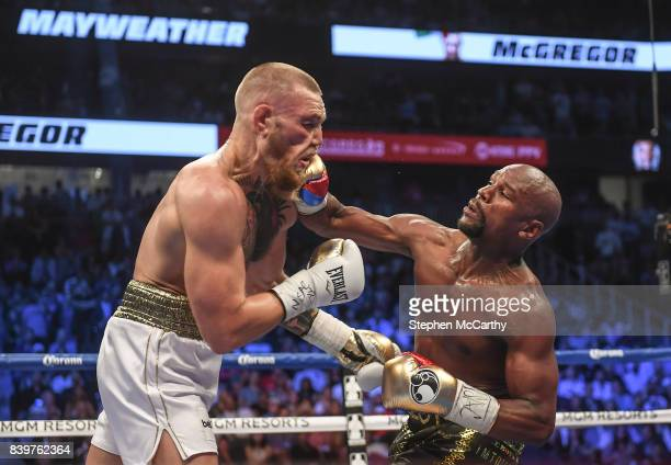 Nevada United States 26 August 2017 Conor McGregor left and Floyd Mayweather Jr during their super welterweight boxing match at TMobile Arena in Las...