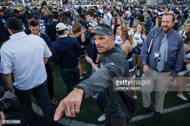 Nevada Wolf Pack coach Jay Norvell in the middle of the chaos on the field after the win over the UNLV Rebels at Mackay Stadium on November 25 2017...