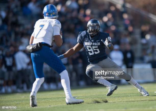 Nevada Wolf Pack defensive end Patrick Choudja goes after San Jose State Spartans quarterback Montel Aaron during the college football game between...