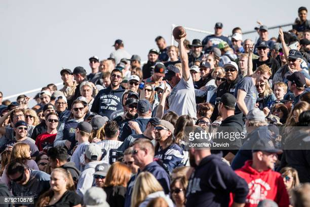 Nevada Wolf Pack fan catches the ball after a field goal kick against the UNLV Rebels at Mackay Stadium on November 25 2017 in Reno Nevada