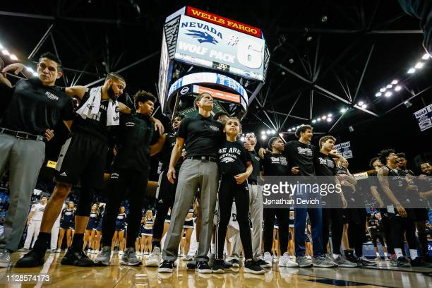 Nevada Wolf Pack players stand with head coach Eric Musselman of the Nevada Wolf Pack and his daughter Mariah Musselman after beating the New Mexico...