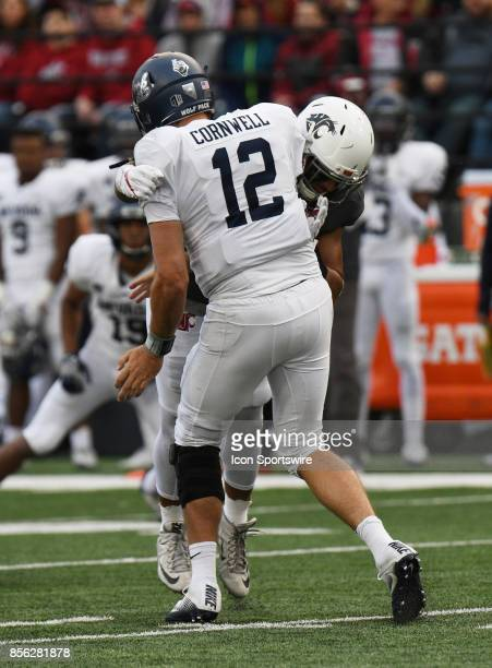 Nevada Wolf Pack quarterback David Cornwell takes a hit from Washington State Cougars linebacker Frankie Luvu on this play where a roughing the...