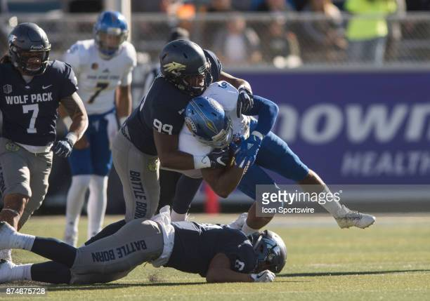 Nevada Wolf Pack quarterback Ty Gangi is nearly sacked by San Jose State Spartans defensive end Brett Foley during the college football game between...