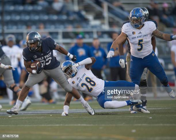 Nevada Wolf Pack wide receiver Andrew Celis evades San Jose State Spartans linebacker Tysyn Parker during the college football game between the San...