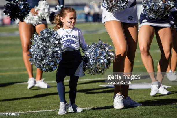 Nevada Wolf Pack wolf pup dances on the field with Wolf Pack cheerleaders before the start of todays game against the San Jose State Spartans at...