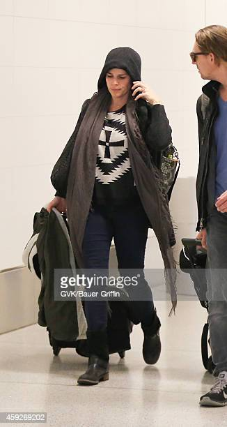 Neve Campbell and JJ Feild seen at LAX on November 19 2014 in Los Angeles California