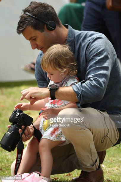 Neve Te Aroha Arden Gayford, with her dad Clarke Gayford, listens to her mother Prime Minister Jacinda Ardern speak at the upper Treaty grounds Te...