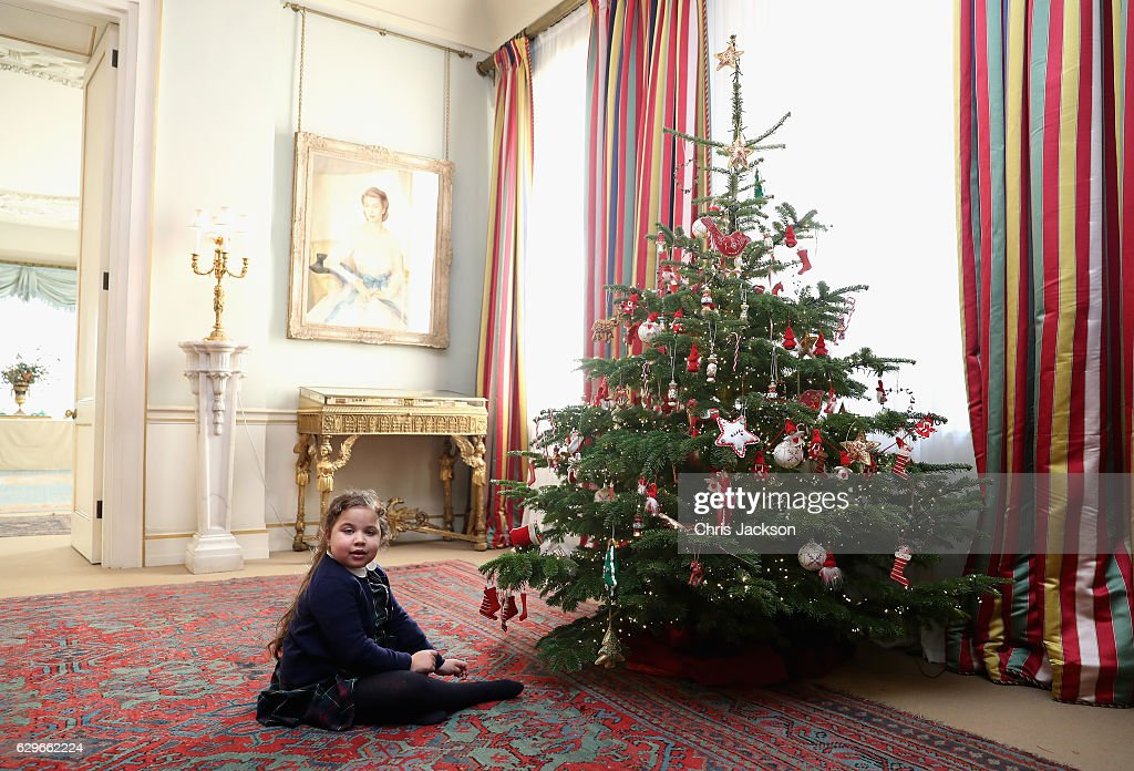 Neve Trainor (aged 6) from Helen and Douglas House decorates the Clarence House Christmas tree during a reception at Clarence House on December 14, 2016 in London, England. The Duchess of Cornwall, Patron, Helen & Douglas House invited children from the charity and children supported by Roald Dahl's Marvellous Children's Charity to decorate the Christmas tree and join Her Royal Highness for lunch at Clarence House.