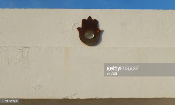 neve tzedek, the hamsa, a good luck charm on old houses - hamsa symbol stock photos and pictures