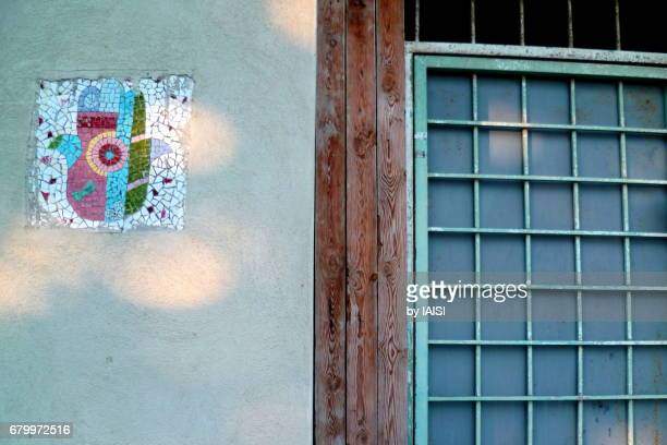 neve tzedek, the hamsa, a good luck charmson old houses - hand of fatima stock photos and pictures