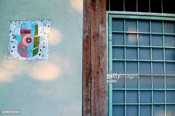 neve tzedek, the hamsa, a good luck charmson old houses - hamsa symbol stock photos and pictures