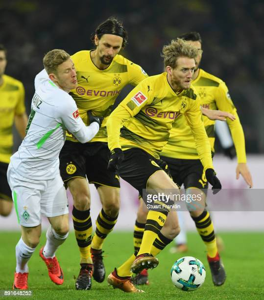 Neven Subotic and André Schürrle of Dortmund are challenged by Florian Kainz of Bremen during the Bundesliga match between Borussia Dortmund and SV...