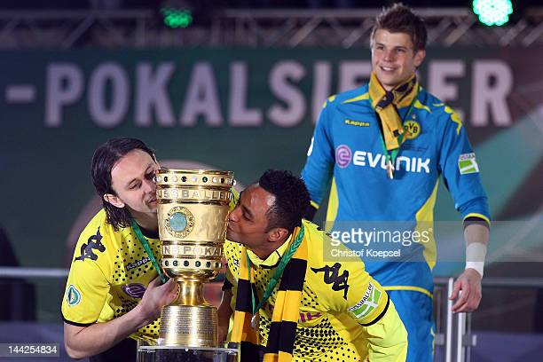 Neven Subotic and Antonio da Silva of Dortmund kiss the trophy after winning the DFB Cup final match between Borussia Dortmund and FC Bayern Muenchen...