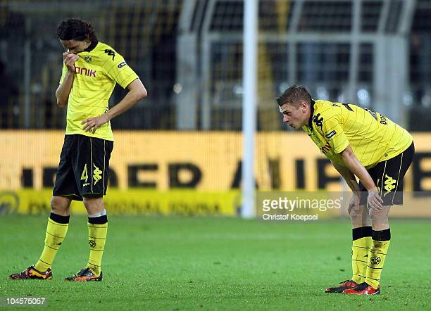 Neven Subotic and Lukasz Piszczek of Dortmund look dejected after losing 0-1 the UEFA Europa League group J match between Borussia Dortmund and...