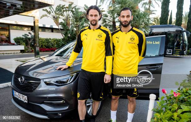 Neven Subotic and Oemer Toprak of Borussia Dortmund playing the game 'Opel Quiz Taxi' during a training session as part of the training camp at the...