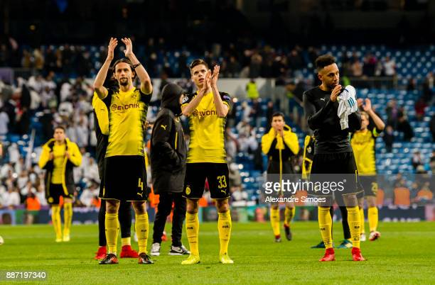 Neven Subotic Julian Weigl and PierreEmerick Aubameyang of Borussia Dortmund after the final whistle during the UEFA Champions League match between...