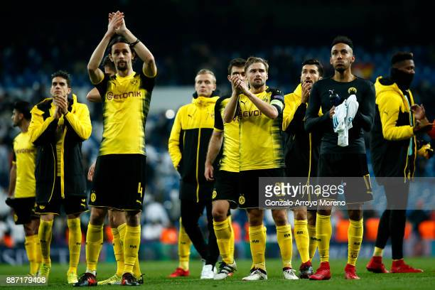 Neven Subotic Marcel Schmelzer and PierreEmerick Aubameyang of Borussia Dortmund clap the fans after the UEFA Champions League group H match between...