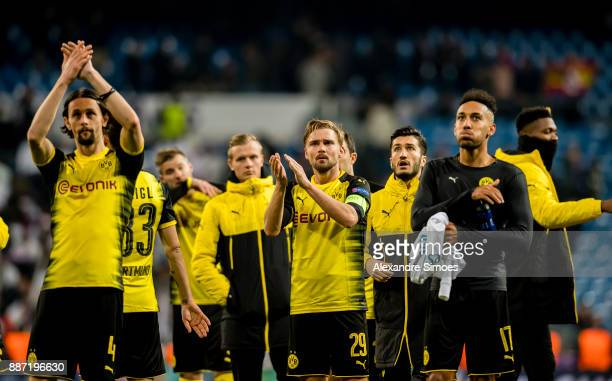 Neven Subotic Marcel Schmelzer and PierreEmerick Aubameyang of Borussia Dortmund after the final whistle during the UEFA Champions League match...