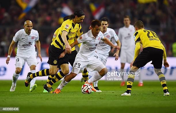 Neven Subotic of Borussia Dortmund chases Shinji Okazaki of 1. FSV Mainz 05 during the Bundesliga match between Borussia Dortmund and 1. FSV Mainz 05...