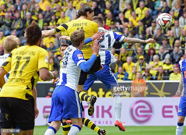 Neven Subotic of Borussia Dortmund heads the ball against Marvin Plattenhardt of Hertha BSC during the game between Borussia Dortmund and Hertha BSC...