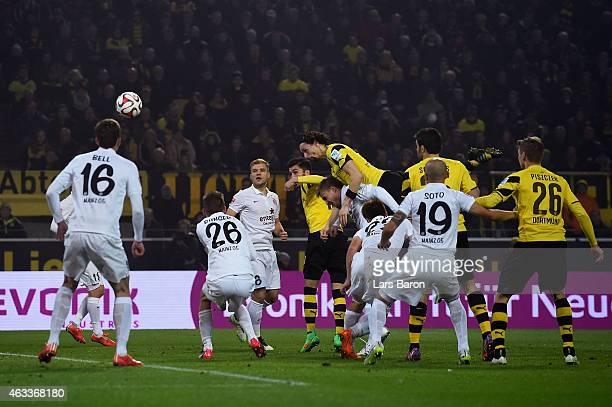 Neven Subotic of Borussia Dortmund heads their first goal during the Bundesliga match between Borussia Dortmund and 1. FSV Mainz 05 at Signal Iduna...